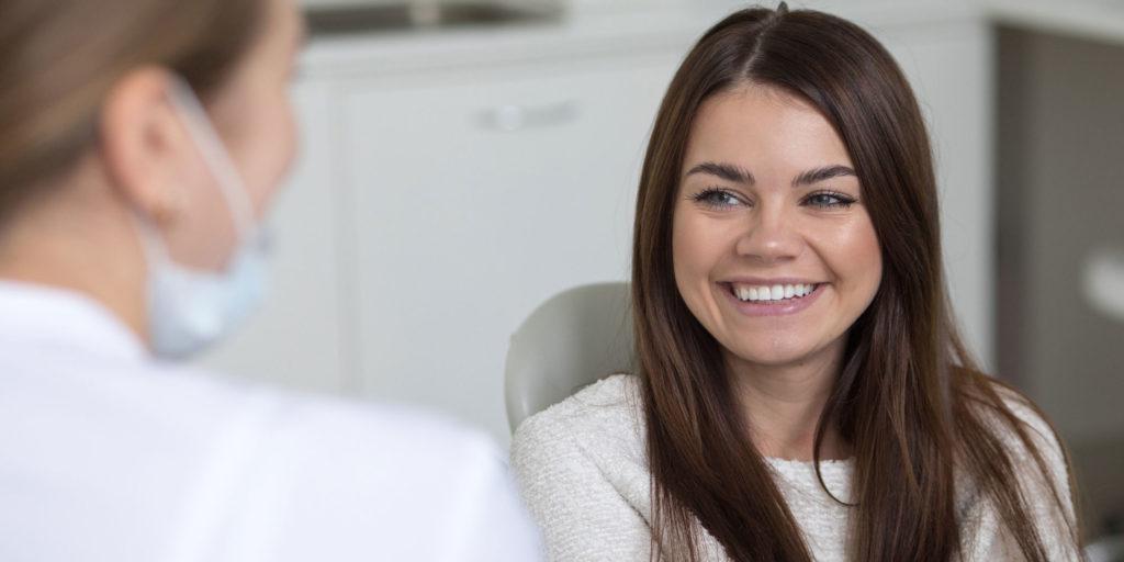 dental patient discussing medical precautions