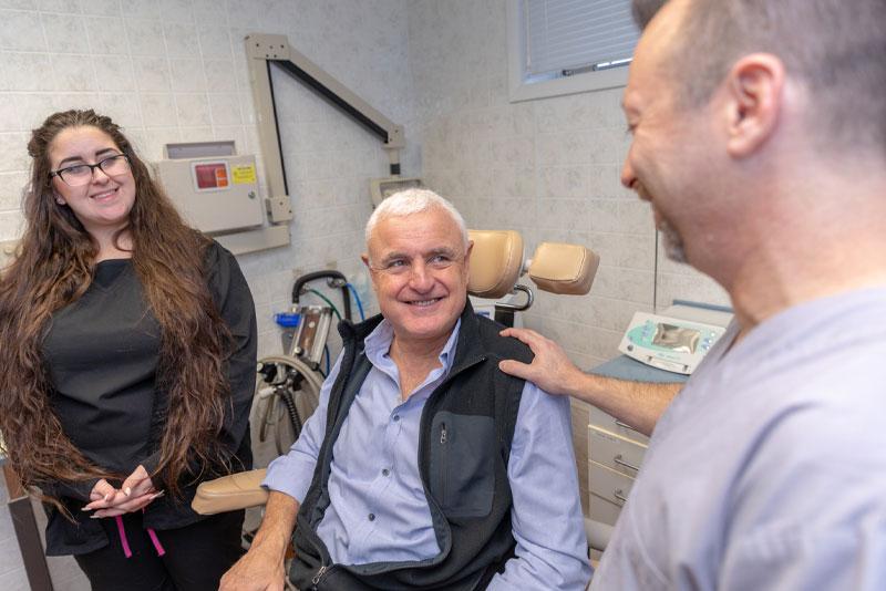 dr schenkman discussing dental procedure