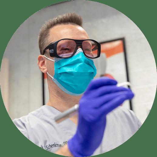 dr schenkman performing dental laser procedure